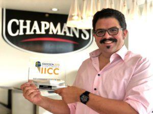 Ashley Chapman holding an IICC Award